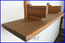 Custom mahogany floating wall shelf in the style of Pierre Chapo Bibliotheque