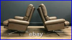 Vintage chocolate brown Leather swivel armchairs / lounge chairs Matching Pair